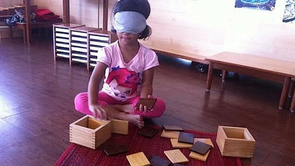 AMI Montessori training child with shapes