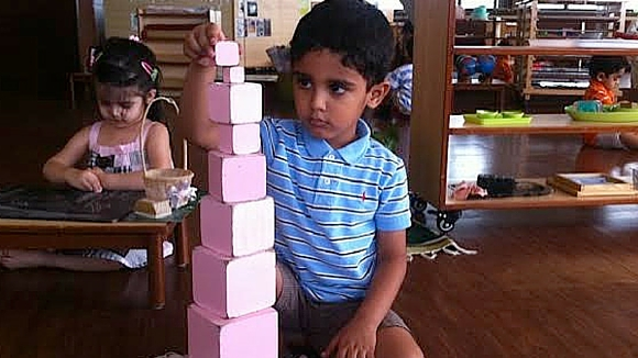 AMI Montessori Training Child Stacking Blocks