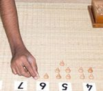 Manipulating numbers with cards and counters for Math - RTI Montessori Training